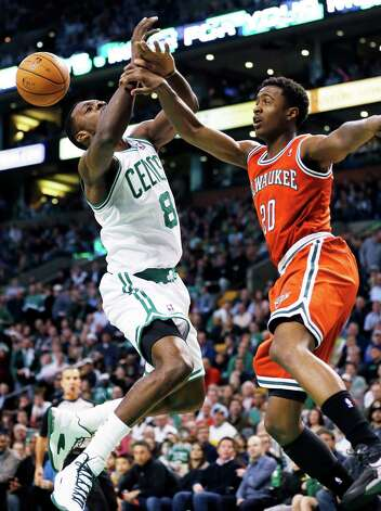 Milwaukee Bucks' Doron Lamb (20) fouls Boston Celtics' Jeff Green (8) during the first quarter of an NBA basketball game in Boston, Friday, Dec. 21, 2012. (AP Photo/Michael Dwyer) Photo: Michael Dwyer
