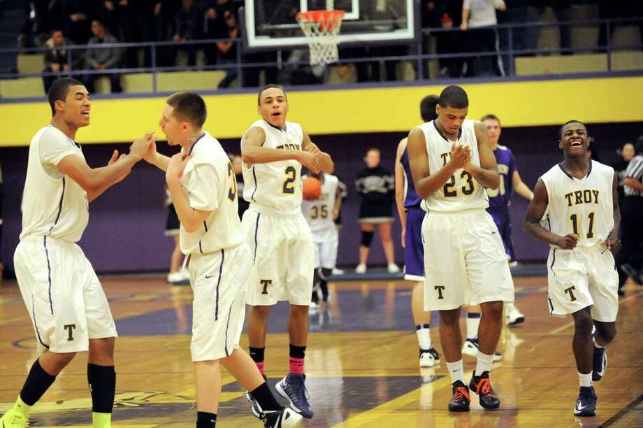 Troy's basketball team celebrates their win over Christian Brothers Academy on Friday, Dec. 21, 2012, at Troy High in Troy, N.Y. (Cindy Schultz / Times Union) Photo: Cindy Schultz / 00020521A