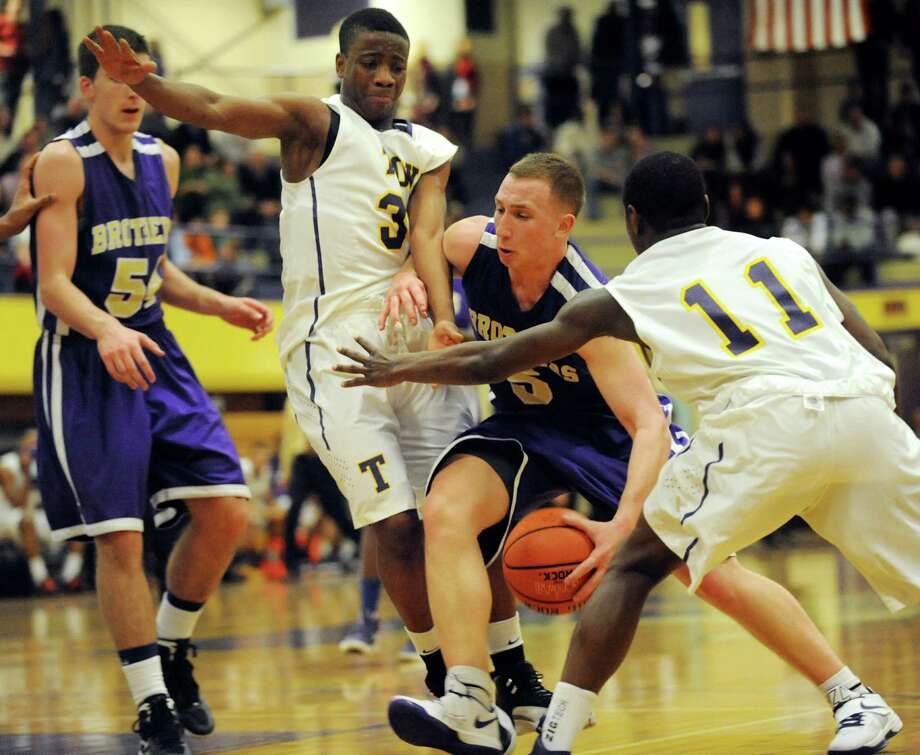 CBA's Nick Marini (5), center, drives between Troy's Zach Radz (3), left, and Dyaire Holt (11) during their basketball game on Friday, Dec. 21, 2012, at Troy High in Troy, N.Y. (Cindy Schultz / Times Union) Photo: Cindy Schultz / 00020521A
