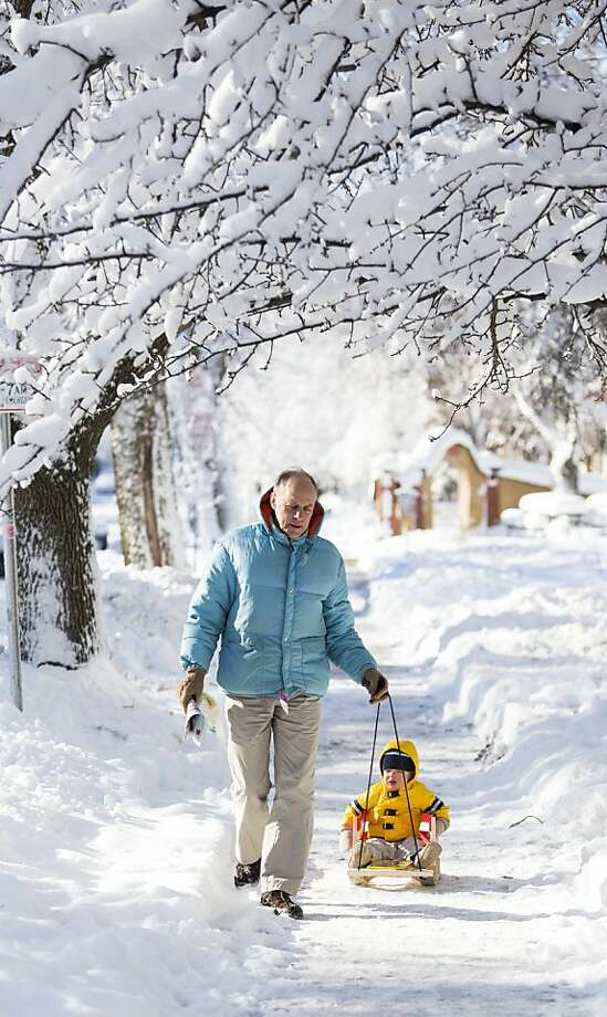 Frank Gloss pulls his grandson, Liam, 17 months old, along a sidewalk December 21, 2012 in Madison, Wisconsin, a day after Wisconsin was blanketed with a record snow storm. Photo: Andy Manis, Getty Images