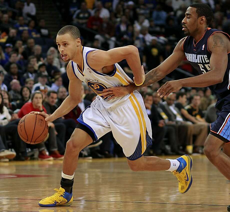 Warriors Stephen Curry, (30) is chased by the Bobcats Reggie Williams, (55) as the Golden State Warriors went on to beat the Charlotte Bobcats 115-100 in NBA action at the in Oakland, Calif. on Friday Dec. 21,2012. Photo: Michael Macor, The Chronicle