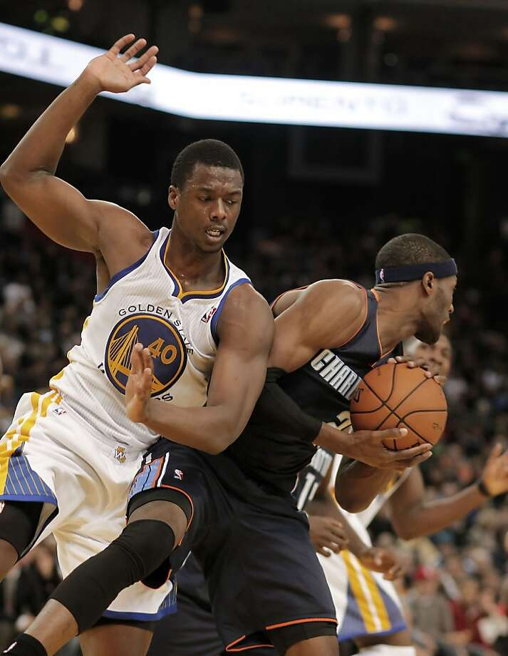 Warriors Harrison Barnes, (40) nand Bobcats Hakim Warrick, (21) battle for a second half rebound, as the Golden State Warriors went on to beat the Charlotte Bobcats 115-100, in NBA action at the in Oakland, Calif. on Friday Dec. 21,2012. Photo: Michael Macor, The Chronicle