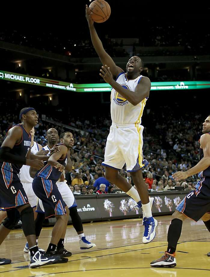 Warriors Draymond Green, (23) splits the Bobcats defense for a first quarter basket, as the Golden State Warriors take on the Charlotte Bobcats in NBA action in Oakland, Calif. on Friday Dec. 21,2012. Photo: Michael Macor, The Chronicle