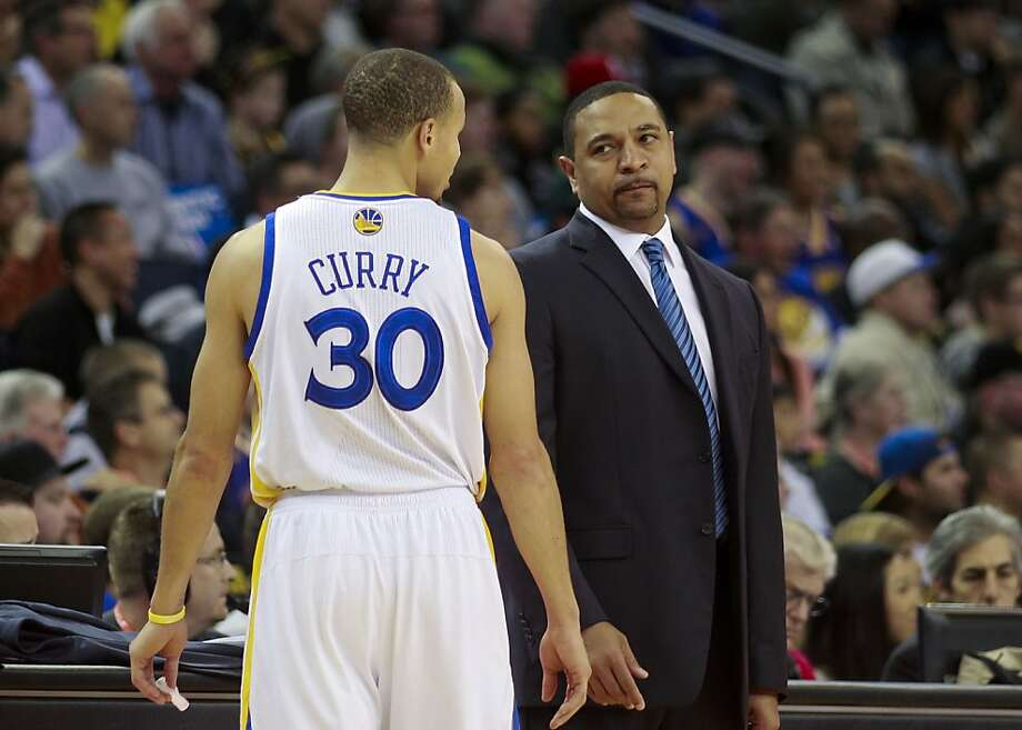 Warriors Stephen Curry, (30) and head coach Mark Jackson at the end of the first quarter, as the Golden State Warriors take on the Charlotte Bobcats in NBA action at the in Oakland, Calif. on Friday Dec. 21,2012. Photo: Michael Macor, The Chronicle