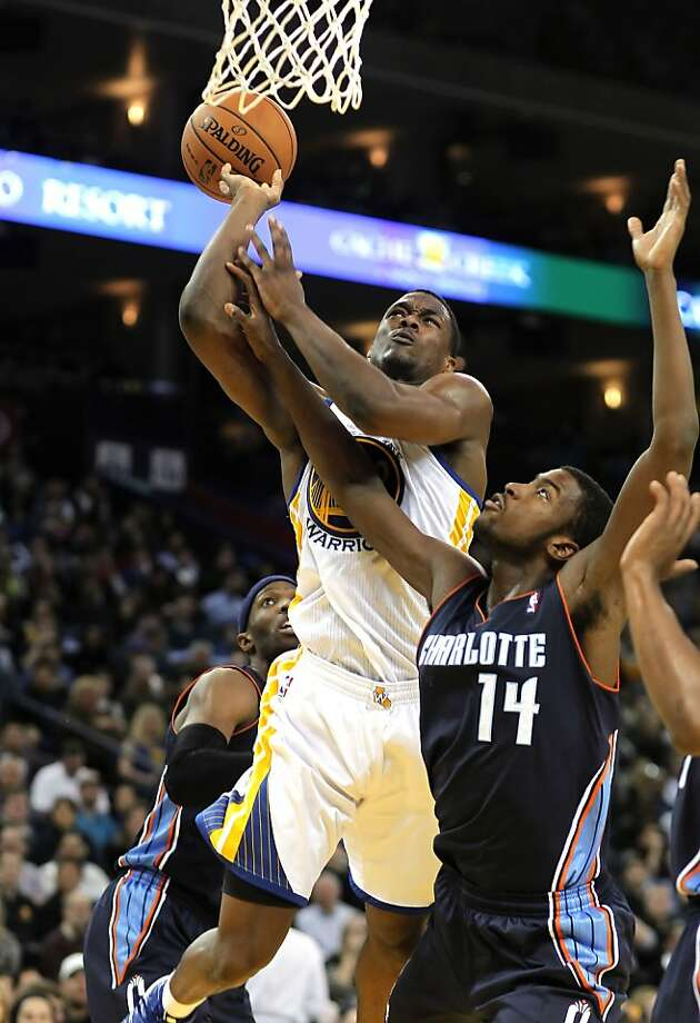 Warriors Harrison Barnes, (40) is fouled by Charlotte's Michael Kidd-Gilhrist, (14) as the Golden State Warriors went on to beat the Charlotte Bobcats 115-100,  in NBA action at the in Oakland, Calif. on Friday Dec. 21,2012. Photo: Michael Macor, The Chronicle