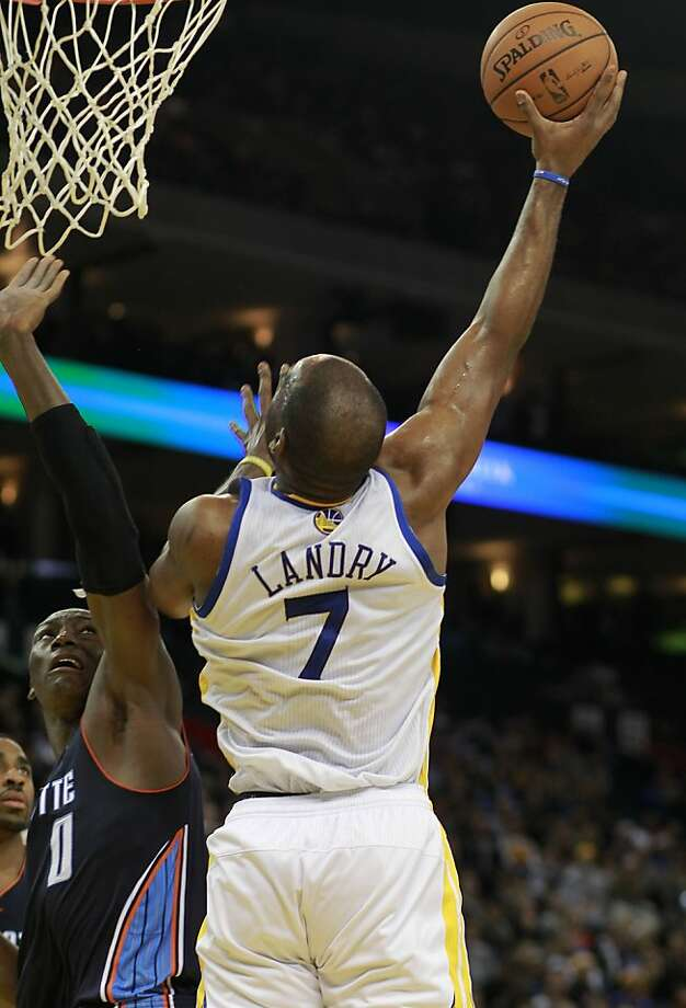Warriors Carl Landry, (7) up for a shot against the Bobcats Bismack Biyombo, (0)  as the Golden State Warriors went on to beat the Charlotte Bobcats 115-100 in NBA action at the in Oakland, Calif. on Friday Dec. 21,2012. Photo: Michael Macor, The Chronicle
