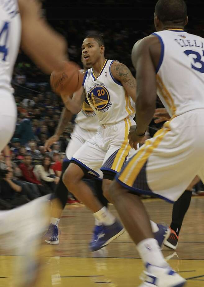 Warriors Kent Bazemore, (20) passes in the fourth quarter,  as the Golden State Warriors went on to beat the Charlotte Bobcats 115-100 in NBA action at the in Oakland, Calif. on Friday Dec. 21,2012. Photo: Michael Macor, The Chronicle