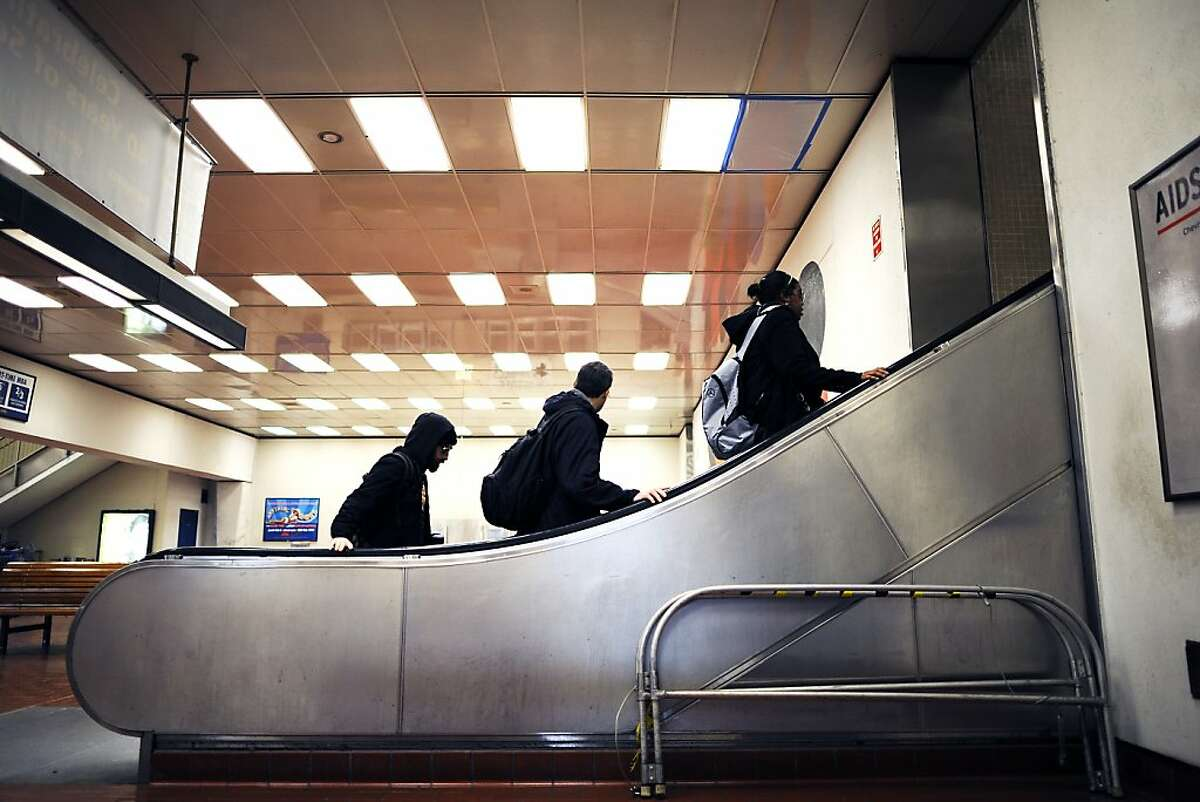 Passengers are seen on the escalators at the MacArthur BART stop in Oakland CA Friday December 21st, 2012.