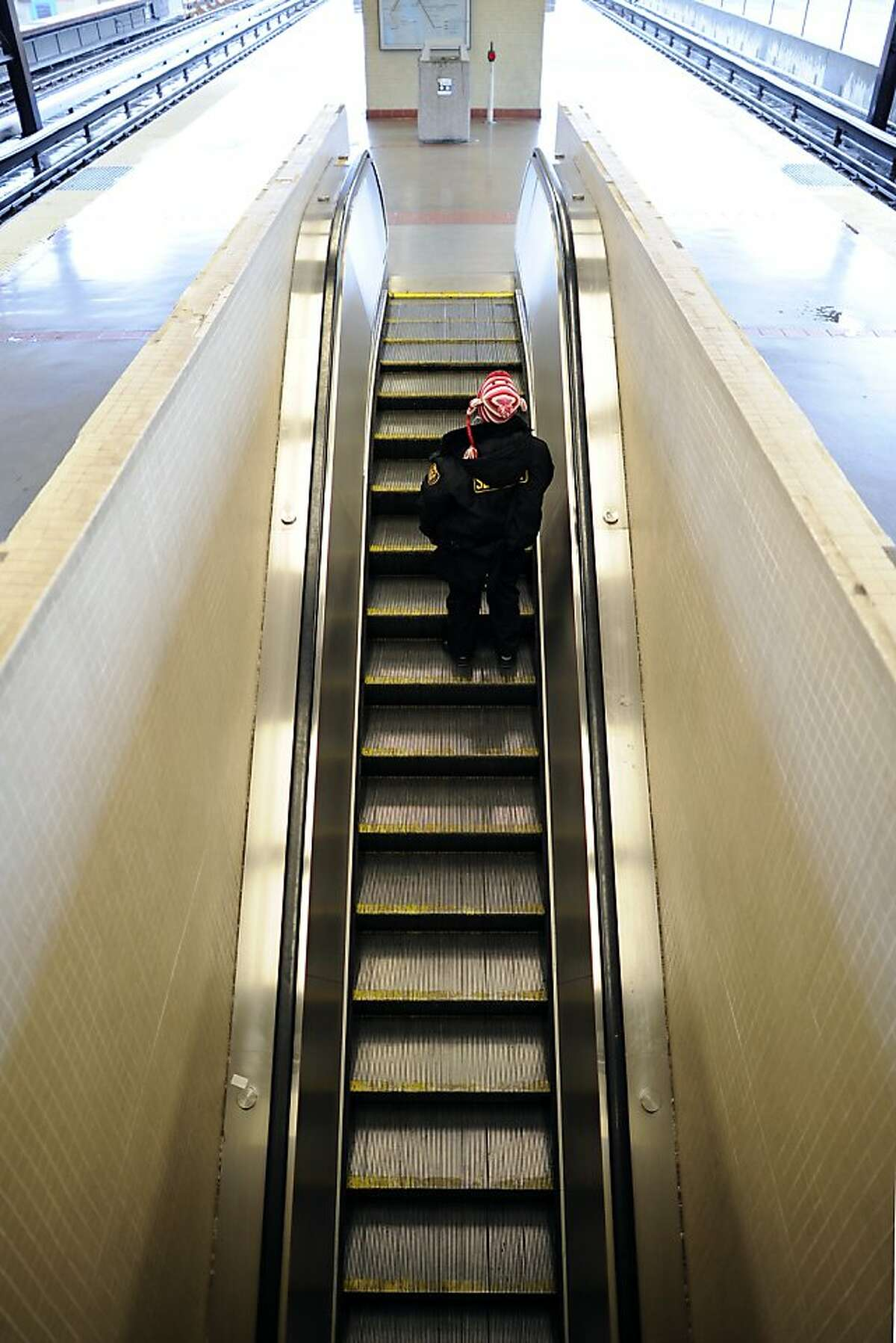 Passengers are seen on the escalators at the MacArthur BART stop in Oakland, CA Friday December 21st, 2012.