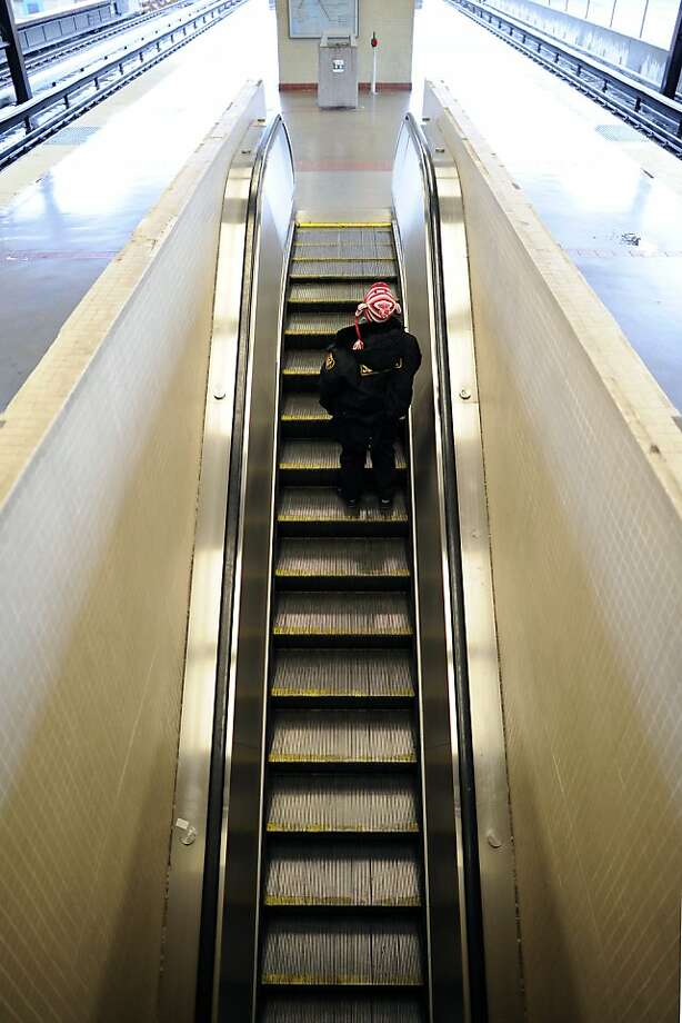 A passenger rides an escalator last week  at the MacArthur BART Station in Oakland, one of 179 escalators in the BART system. Photo: Michael Short, Special To The Chronicle