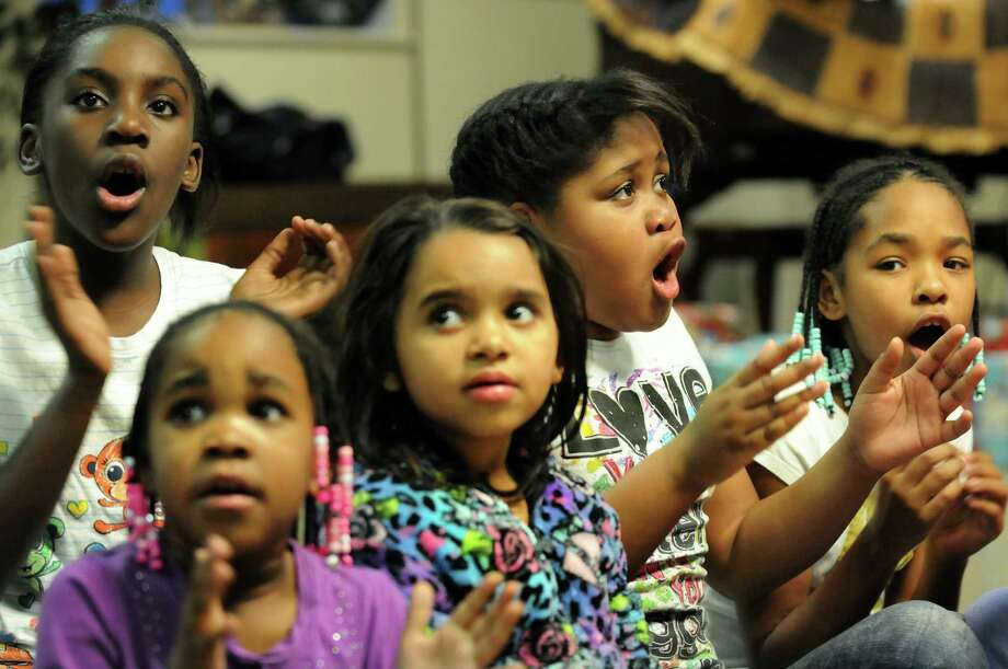 Girls sing holiday songs while they wait for Santa to arrive during a holiday party on Thursday, Dec. 20, 2012, at Hamilton Hill Arts Center in Schenectady, N.Y. (Cindy Schultz / Times Union) Photo: Cindy Schultz / 00020536A