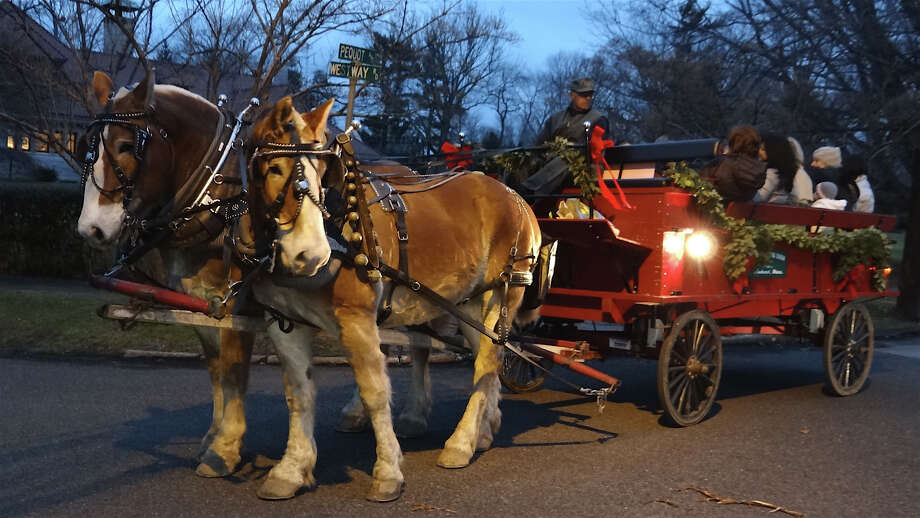Horse-and-buggy rides throught the chilly Friday evening air were offered to attendees at the Peqot Library's annual holiday party and caroling.  Fairfield CT 12/21/12 Photo: Mike Lauterborn / Fairfield Citizen contributed