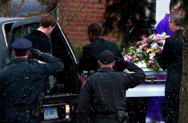 Police salute as the casket of Josephine Gay is loaded into a hearse after her funeral at St. Rose of Lima Roman Catholic Church, Saturday, Dec. 22, 2012, in Newtown. Gay was one of 26 killed after gunman Adam Lanza opened fire killing 26 individuals, 20 whom were children, at Sandy Hook Elementary School last Friday. Photo: Cody Duty, Cody Duty/Hearst Newspapers / The News-Times