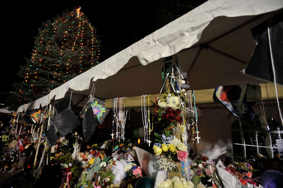 A cross is erected near the Christmas tree in the center of Sandy Hook on Friday, Dec. 21, 2012, a week after the shooting at Sandy Hook Elementary School. Photo: Jason Rearick / The News-Times
