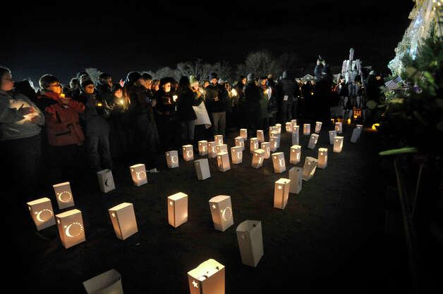 Mourners attend the vigil at Fairfield Hills Campus in Newtown on Friday, Dec. 21, 2012, one week after the shooting at Sandy Hook Elementary School. Photo: Jason Rearick / The News-Times