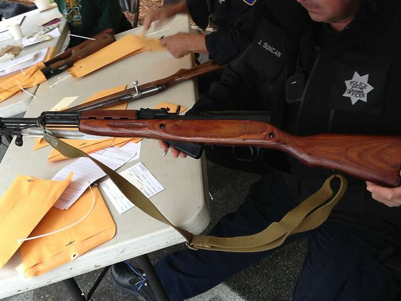 Oakland police collect guns in a buy-back program last weekend that was bankrolled by a medical mari