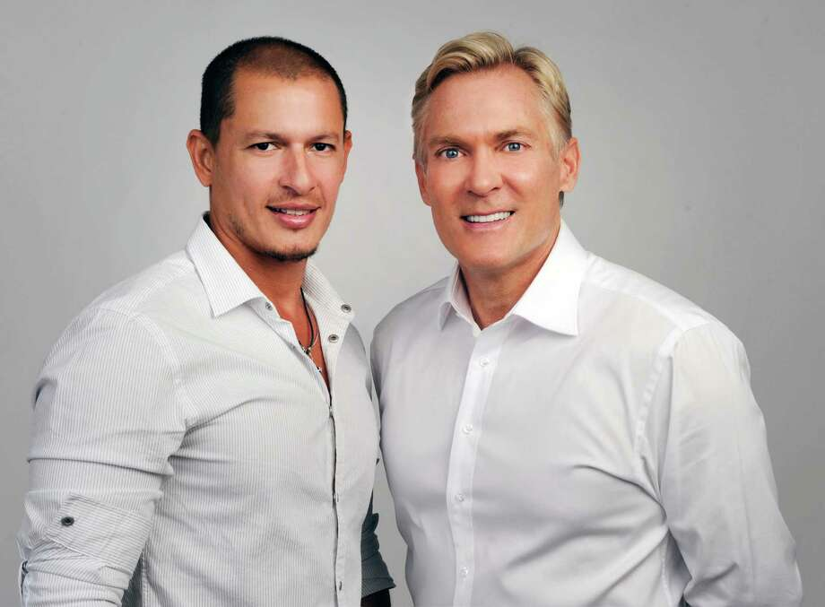 "FILE-  This this May 2012 file photo released by ABC shows ""Good Morning America"" weatherman Sam Champion, right, and artist Rubem Robierb in New York. According to ABC, the couple wed in a small ceremony at Champion's New York apartment on Friday, Dec. 21, 2012. (AP Photo/ABC, Ida Mae Astute, File) Photo: Ida Mae Astute"