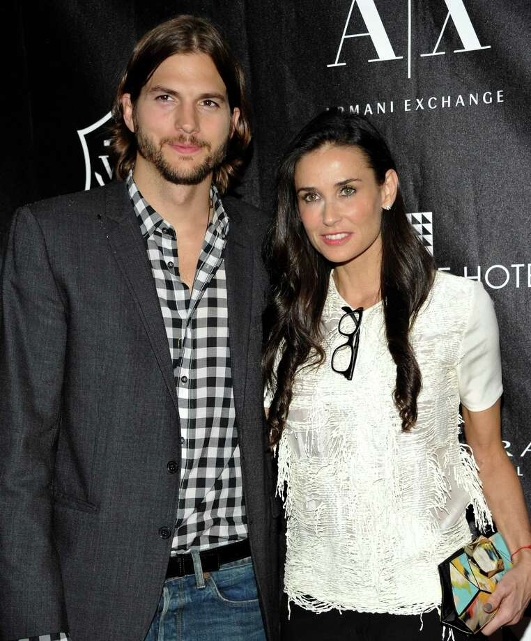 FILE - In this June 9, 2011 file photo, actors Ashton Kutcher and Demi Moore attend the first annual Stephan Weiss Apple Awards at the Urban Zen Center in New York.  Court records show Kutcher filed for divorce from Moore on Friday, Dec. 21, 2012, citing irreconcilable differences. (AP Photo/Evan Agostini, file) Photo: Evan Agostini