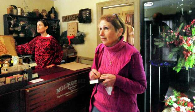 Suzanne Knight, left, and Linda Manna, owner of The Country Mill, talk about business in Sandy Hook, Newtown Saturday, Dec. 22, 2012. Photo: Michael Duffy / The News-Times