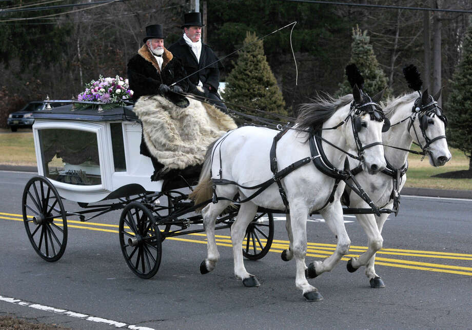 Bloomfield, CT - 10/22/12 - A horse-drawn carriage on E. Wintonbury Avenue, carries Ana Grace Marquez-Greene's casket to The First Cathedral in Bloomfield Saturday for the wake and service to follow.  BRAD HORRIGAN | bhorrigan@courant.com Photo: Brad Horrigan, Hartford Courant / \12222012\B582603137Z.1