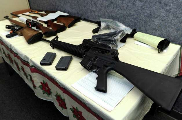 Police collected 40 guns, including this AR-15, in just the first hour of a gun buyback event Saturday, Dec. 22, 2012 at the Bridgeport Police Department's Community Services Division in Bridgeport, Conn. In the wake of the tragedy in Newtown, Conn., the city raised $100,000 for the program and will offer up to $200 value for a working handgun, $75 for rifles and higher amounts for assault-type rifles. Photo: Autumn Driscoll / Connecticut Post