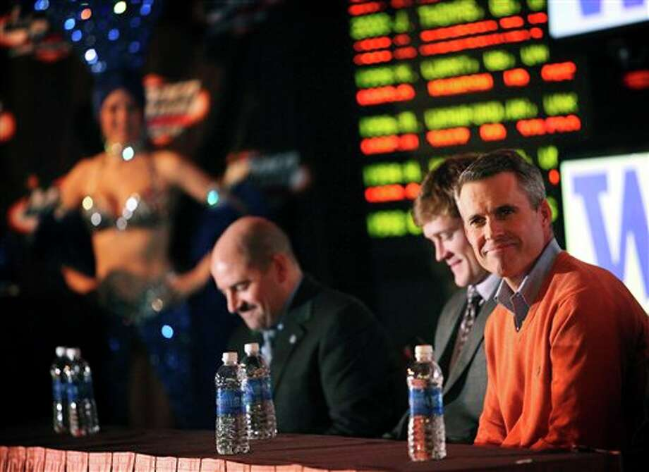 Boise State head coach Chris Petersen, right, smiles during a during a news conference at the New York-New York Hotel and Casino, Thursday, Dec. 6, 2012, to announce details of their MAACO Bowl Las Vegas NCAA college football game against Washington in Las Vegas. The two schools are scheduled to play each other Dec. 22. Photo: Jessica Ebelhar, AP / Las Vegas Review-Journal
