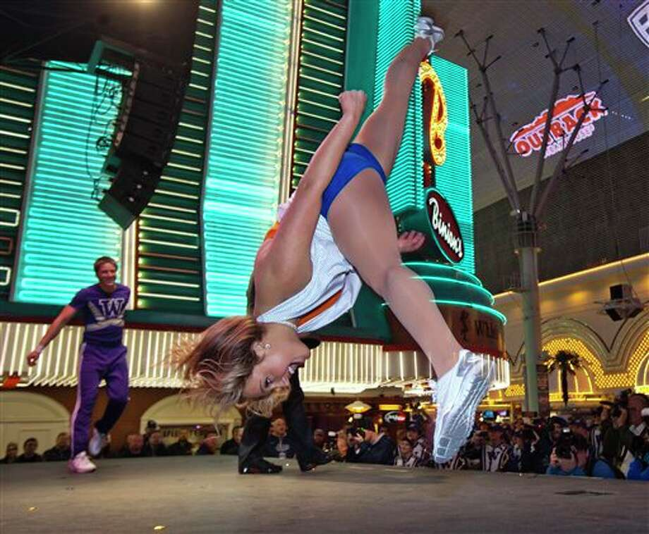 Boise State sophomore Laramie Joseph out-danced a Washington cheerleader as Bronco fans cheer her on at the Maaco Las Vegas Bowl Freemont Street Experience pep rally in downtown Las Vegas, Nev. Photo: Darin Oswald, AP / Idaho Statesman