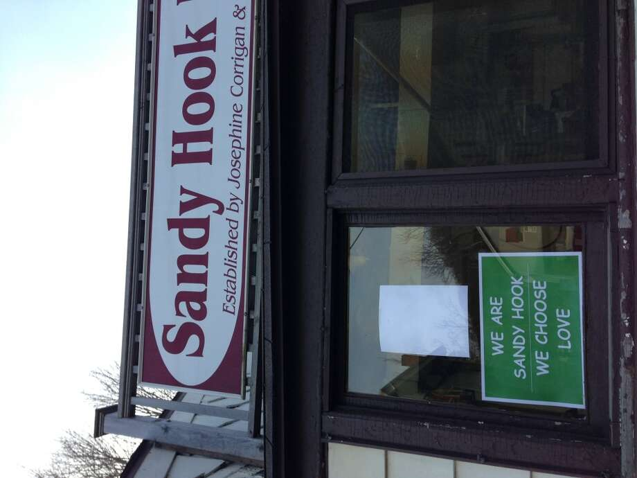This sign appears in many store windows in the community. (Dwight Silverman / Hearst Newspapers)