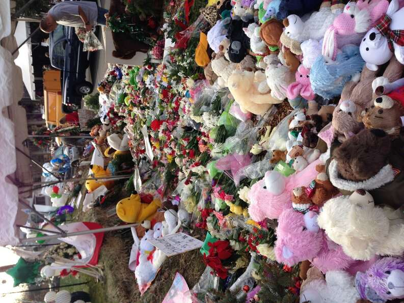 There are literally thousands of teddy bears left behind. (Dwight Silverman / Hearst Newspapers)