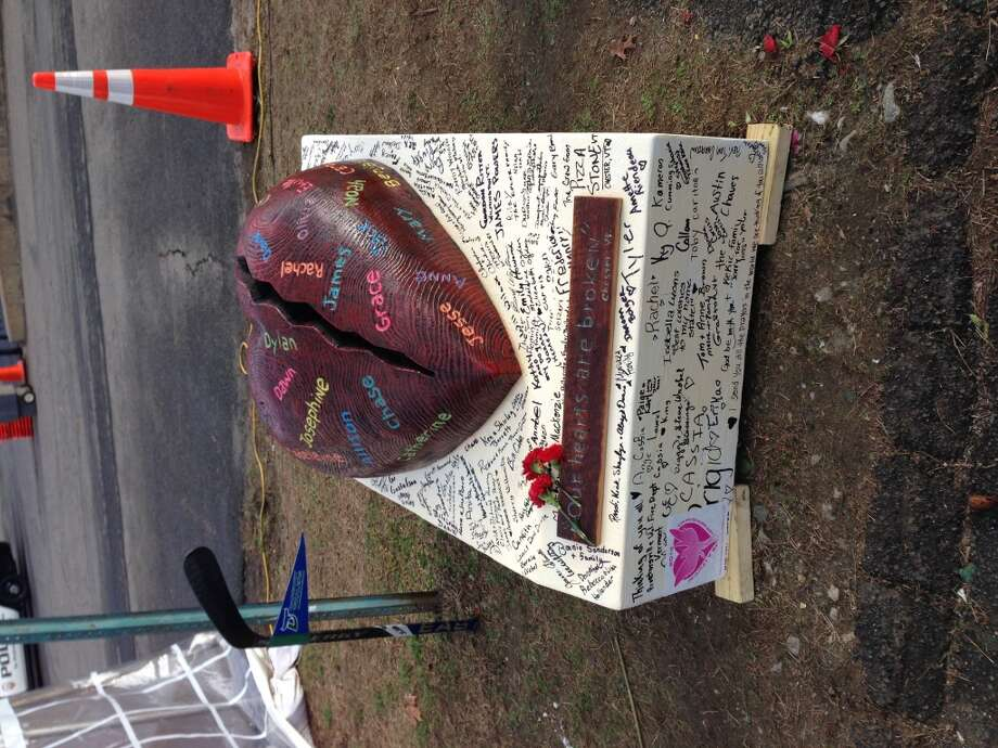An emotional sculpture outside the firehouse. (Dwight Silverman / Hearst Newspapers)