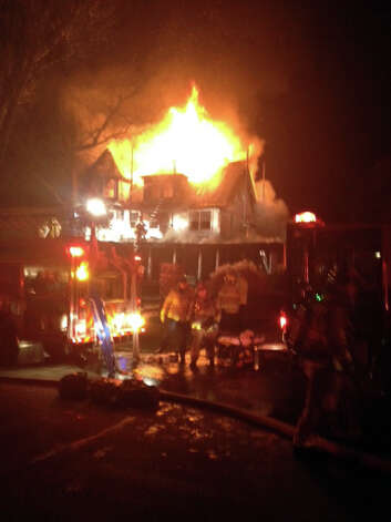 A massive inferno tears through the house at 2267 Shippan Ave. in the pre-dawn hours of Christmas morning. Photo: Contributed Photo / Stamford Advocate Contributed