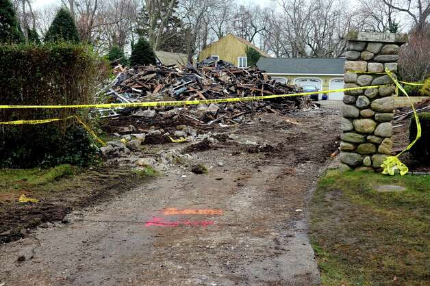The demolished home of Madonna Badger in Stamford on Tuesday, December 27, 2011, where a fire on Christmas morning killed Badger's parents and three daughters. Photo: Lindsay Niegelberg / Stamford Advocate