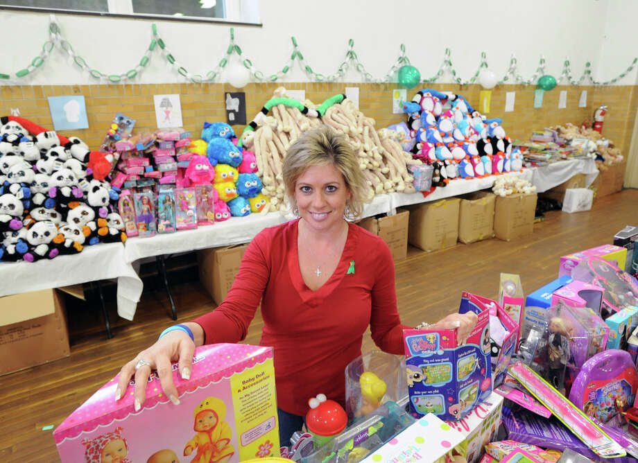 Ann Benore in the basement of Newtown's Edmond Town Hall with toys collected in memory of the victims of Sandy Hook School Shooting for a community toy drive, Newtown, Conn., Saturday afternoon, Dec. 22, 2012. Benore said she is a social worker for Newtown and helped organize the drive with friends and co-workers. Benore said thousands of toys were donated. Photo: Bob Luckey / Greenwich Time
