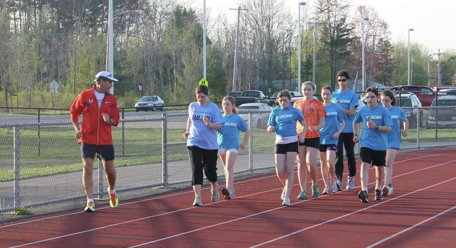 Don Lawrence coaching local students on the technical aspects of racewalking.  Photo submitted by Lawrence