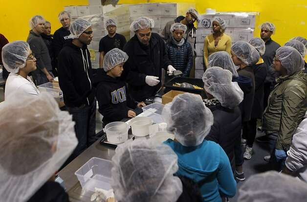 Right: Volunteers get instructions for packaging pasta at the San Francisco and Marin Food Bank. Photo: Paul Chinn, The Chronicle