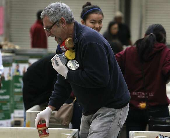 Stuart Koplowitz sorts donated food into separate bins at the San Francisco Food Bank in San Francisco, Calif. on Saturday, Dec. 22, 2012. Photo: Paul Chinn, The Chronicle
