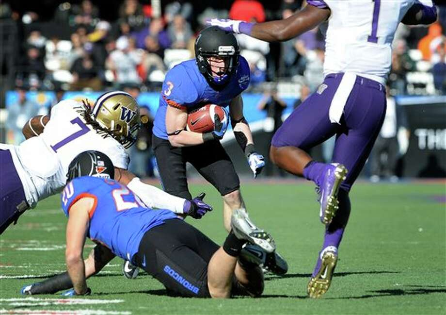 Boise State's Chris Potter (3) looks for an opening during first half of the MAACO Bowl NCAA college football game against Washington, Saturday, Dec. 22, 2012, in Las Vegas. Photo: David Becker, AP / FR170737 AP