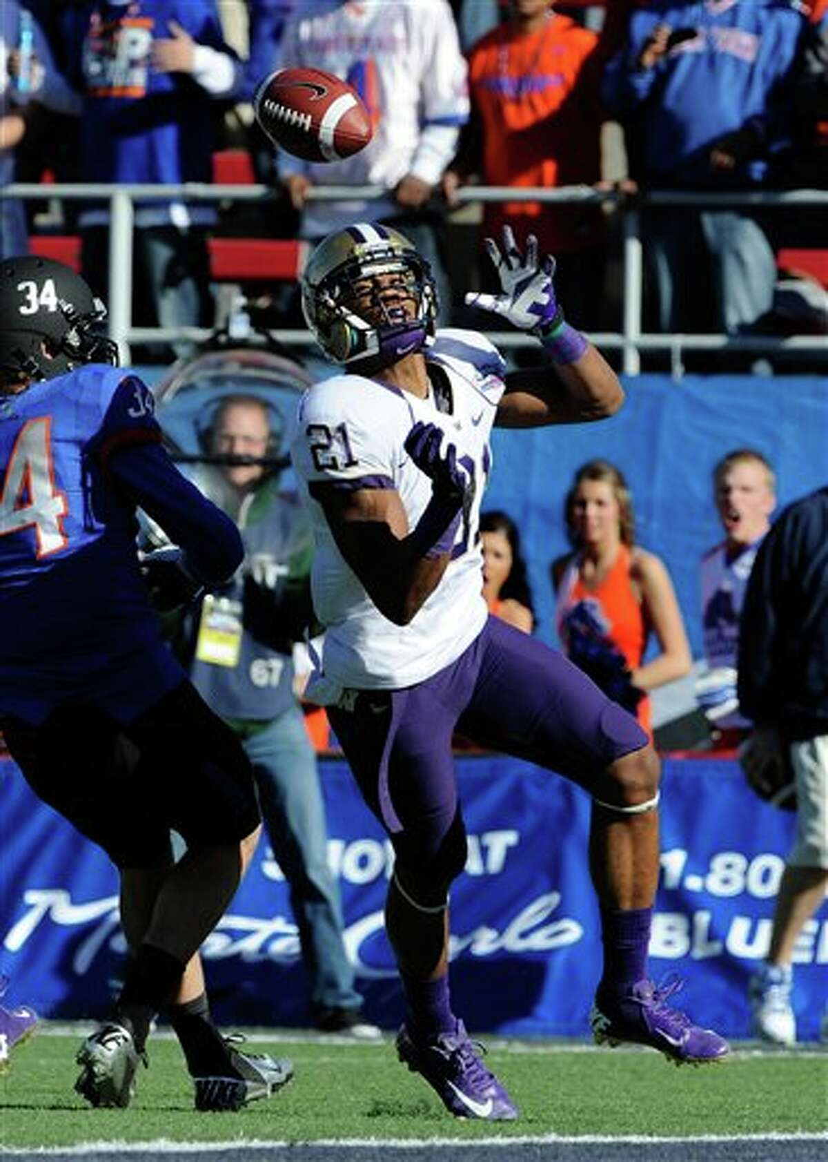 Washington cornerback Marcus Peters breaks up a reception against Boise State Kirby Moore (34) during first half of the MAACO Bowl NCAA college football game on Saturday, Dec. 22, 2012, in Las Vegas.