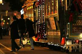 People hop off of a cable car on December 19, 2012 in San Francisco, Calif.