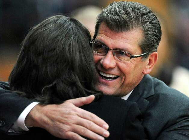 Connecticut head coach Geno Auriemma, right, hugs Hartford head coach Jennifer Rizzotti, left, before a NCAA women's college basketball game in West Hartford, Conn., Saturday, Dec. 22, 2012. Connecticut won 102-45. (AP Photo/Jessica Hill) Photo: Jessica Hill, Associated Press / FR125654 AP