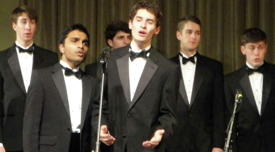 Alan Southworth, center, a 2010 graduate of Staples High School, performs with the Princeton Nassoons, a prestigious a cappella group at the Ivy League university, during a Thursday concert at the Seabury Center.  Westport CT 12/20/12 Photo: Meg Barone / Westport News freelance