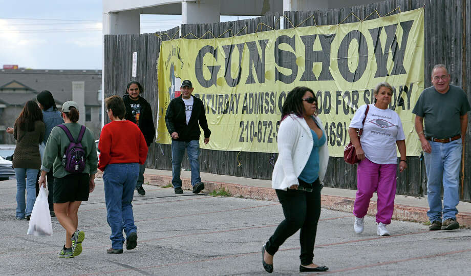 Even before the doors opened Saturday morning, a line of people snaked around the Live Oak Civic Center to attend the gun show. Photo: Tom Reel, San Antonio Express-News / ©2012 San Antono Express-News