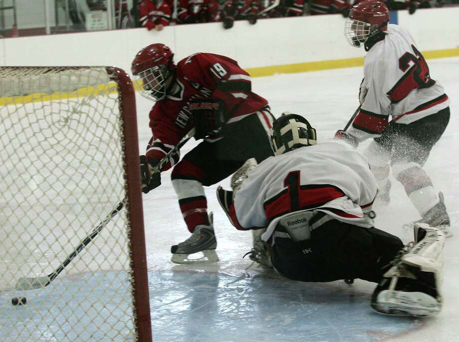 Greenwich High School goalie Bryan Archino could not keep New Canaan's Harry Stanton from scoring in the second period of Saturday's game, Dec. 22, 2012. Photo: DAVID AMES / GREENWICH TIME FREELANCE