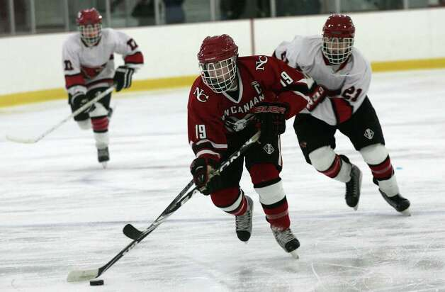 New Canaan High School's Harry Stanton scored the third goal in the second period during Saturday's, Dec. 22, 2012, game against Greenwich at Hamill Rink.  New Canaan went on to win 4-2. Photo: DAVID AMES / GREENWICH TIME FREELANCE