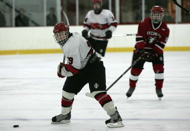 Greenwich High School's Tommy Rogan in action against New Canaan Saturday, Dec. 22, 2012.  New Canaan went on to win 4-2. Photo: DAVID AMES / GREENWICH TIME FREELANCE