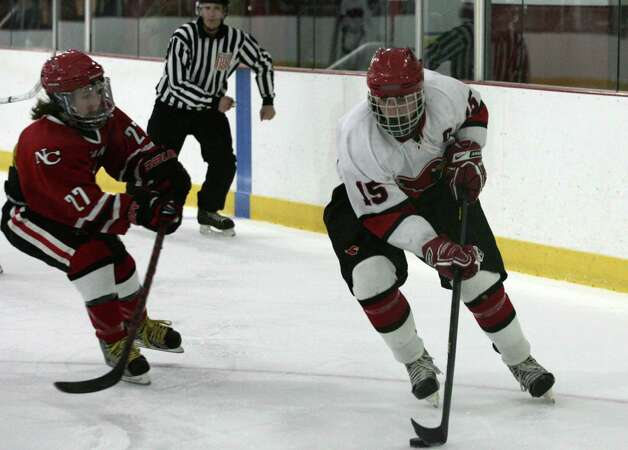 Greenwich High School captain Reed Brady in action against New Canaan Saturday, Dec. 22, 2102.  New Canaan went on to win 4-2. Photo: DAVID AMES / GREENWICH TIME FREELANCE