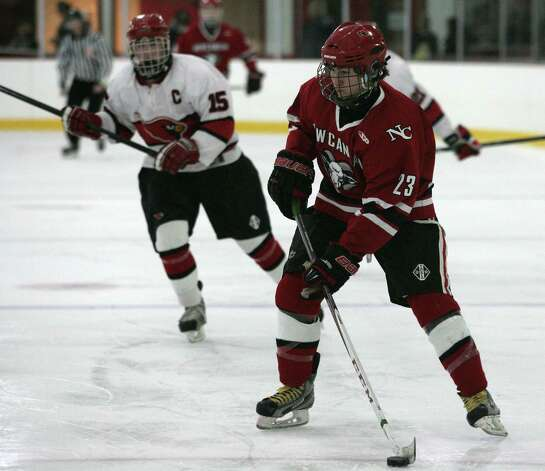 New Canaan's Luke Amero in action against Greenwich Saturday, Dec. 22, 2012.  New Canaan went on to win 4-2. Photo: DAVID AMES / GREENWICH TIME FREELANCE