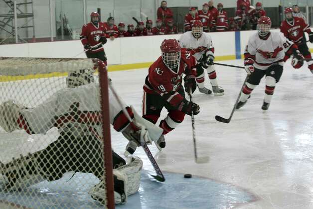 New Canaan's Harry Stanton scored the third goal for the Ram's in Saturday's, Dec. 22, 2012, game against Greenwich.  New Canaan went on to win 4-2. Photo: DAVID AMES / GREENWICH TIME FREELANCE