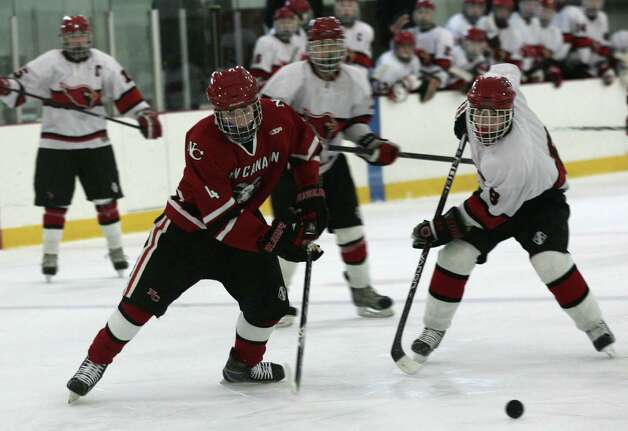 The Greenwich High School Cardinals clashed with the New Canaan Rams at Hamill Rink Saturday, Dec. 22, 2012.  New Canaan went on to win 4-2. Photo: DAVID AMES / GREENWICH TIME FREELANCE