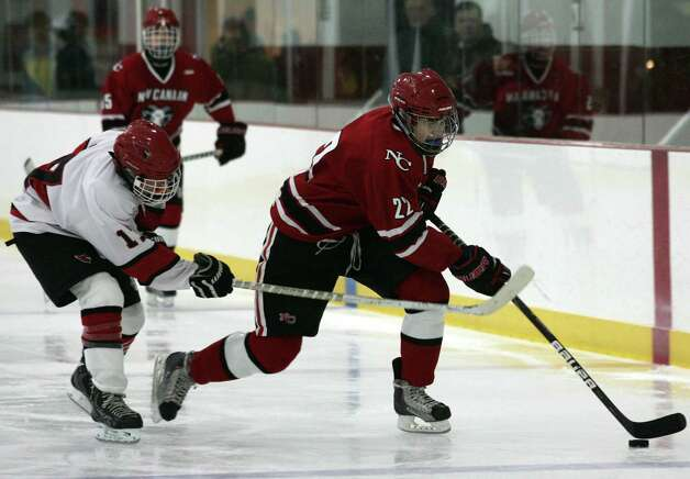 New Canaan's Patrick Hompe in action against Greenwich Saturday, Dec. 22, 2012.  New Canaan went on to win 4-2. Photo: DAVID AMES / GREENWICH TIME FREELANCE